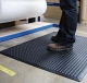 Insulating rubber mat for electric work purpose